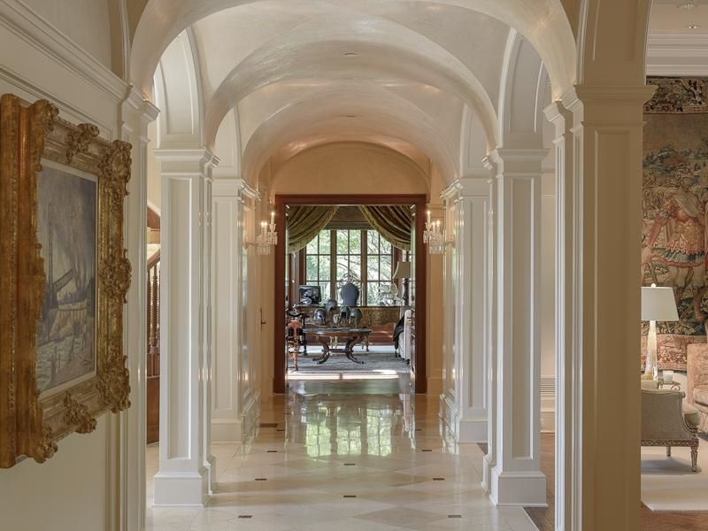 Traditional Hallway with Groin vaulted ceiling, Wall sconce, simple marble floors, Columns, High ceiling, Crown molding