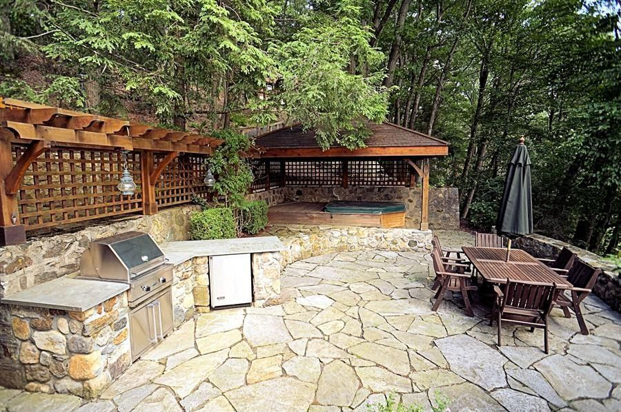 Rustic Patio with Vermont castings 5 burner built-in bbq grill - natural gas, Raised beds, Slate patio, exterior stone floors