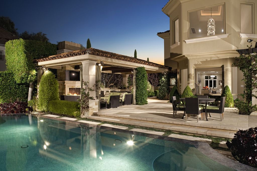 Traditional Swimming Pool with Other Pool Type, exterior stone floors, Outdoor furniture, Cabana, Casement, Pathway, Fence