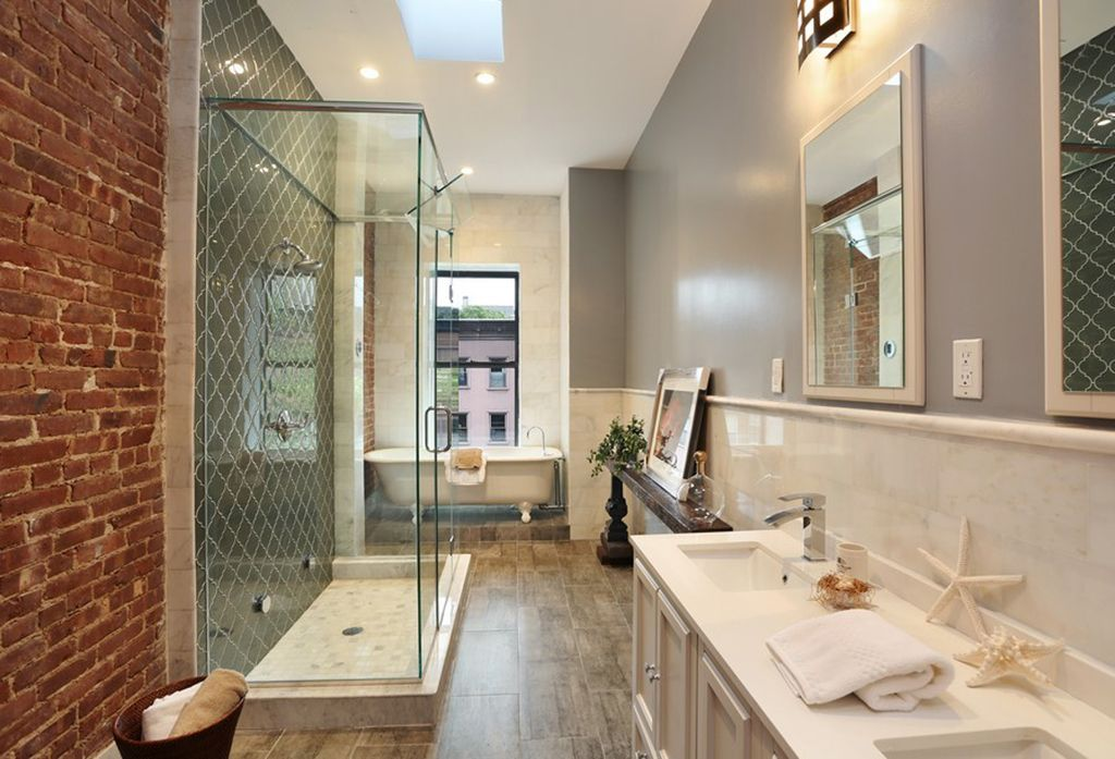 Contemporary Master Bathroom with Corian counters, Skylight, partial backsplash, Paint 2, picture window, Clawfoot, Flush