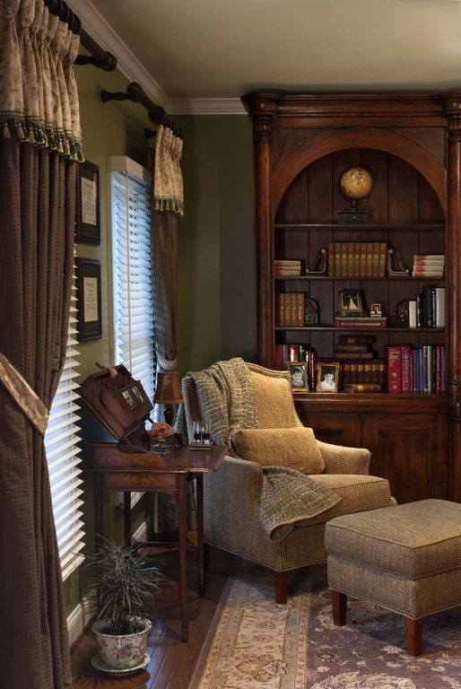 Traditional Living Room with Arched bookshelf, Laminate floors, Hardwood floors, Crown molding, Built-in bookshelf, Area rug