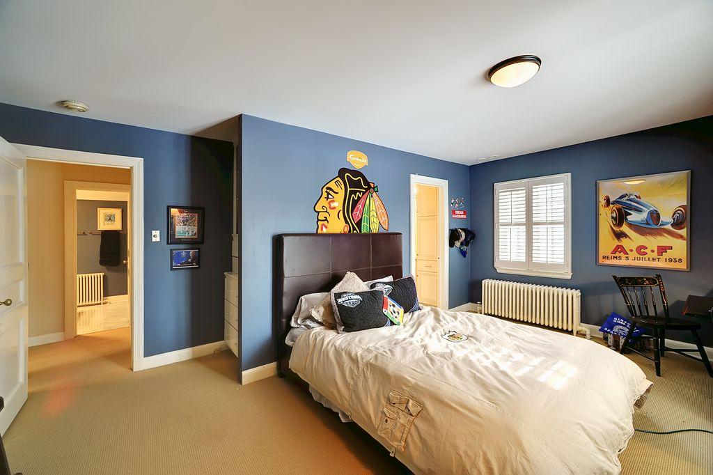 Traditional Kids Bedroom with Carpet, Built-in bookshelf, Mural, flush light, specialty door