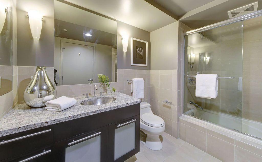 Traditional Full Bathroom with Standard height, Undermount sink, Wall Tiles, Flush, drop in bathtub, limestone tile floors