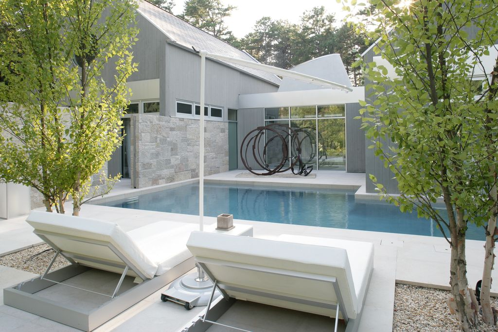 Contemporary Swimming Pool with exterior tile floors, Transom window, sliding glass door, French doors, Other Pool Type