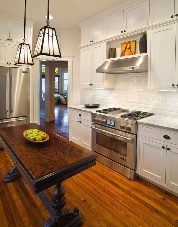 Traditional Kitchen with can lights, Wall Hood, Subway Tile, L-shaped, gas range, Inset cabinets, Standard height