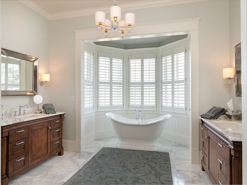 Traditional master bathroom with european cabinets high for Bathroom design wellington