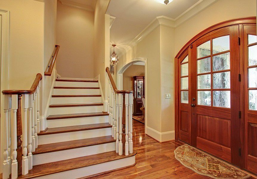 Traditional Entryway with Glass panel door, flush light, High ceiling, Maple - country cinnamon 2.25 in. solid hardwood strip