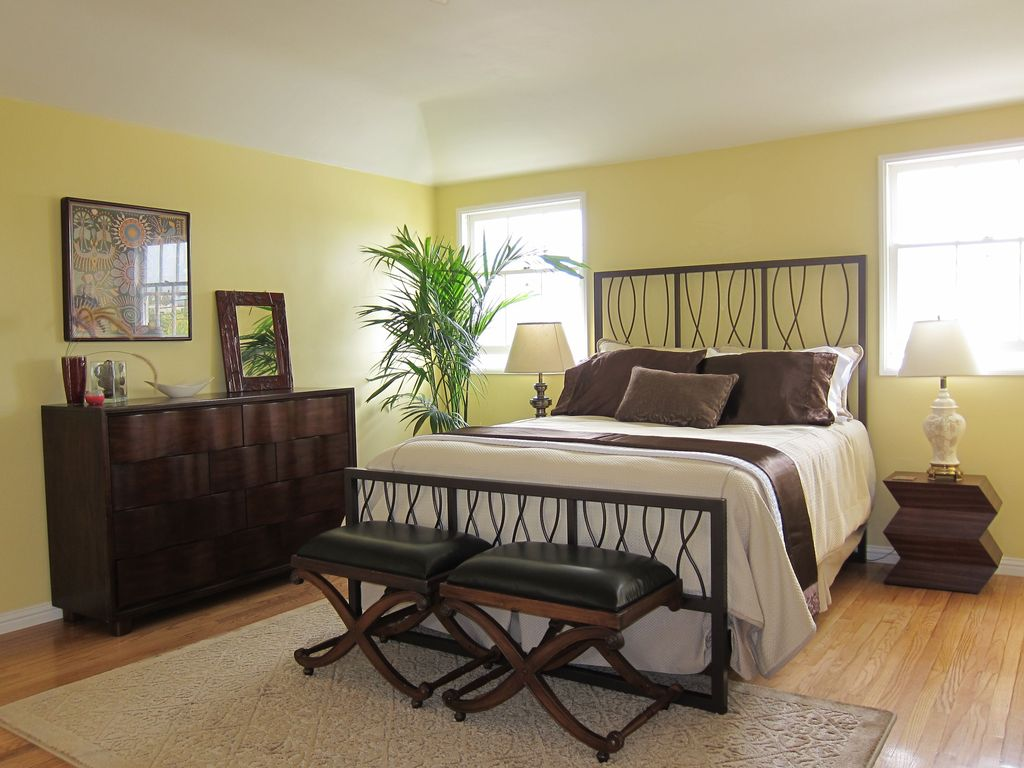 Modern Guest Bedroom with Mural, Hardwood floors, picture window, Carpet, Standard height