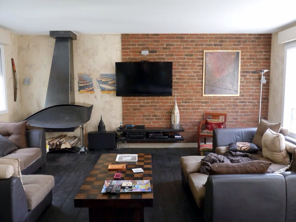 Eclectic Living Room with Wood Stove fireplace, interior brick, Fireplace, Casement, Hardwood floors, Standard height