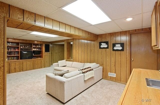 craftsman basement with exposed beam wood paneling in