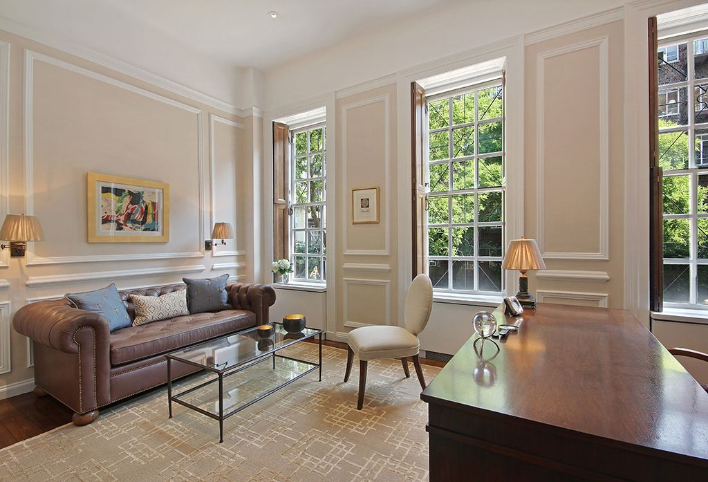 Traditional Home Office with can lights, double-hung window, Wainscotting, Chair rail, Standard height, Hardwood floors