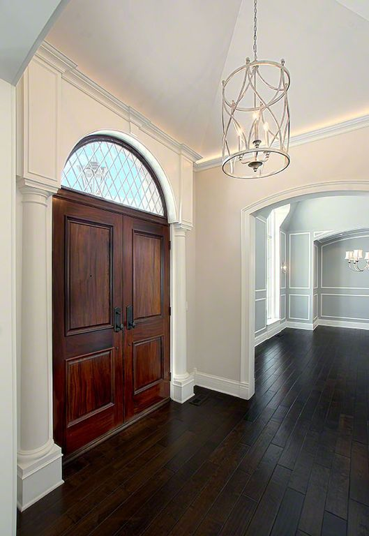 Traditional Entryway with Double wood door, Paint 2, Country french door collection dbyd-2434, Chandelier, Hardwood floors