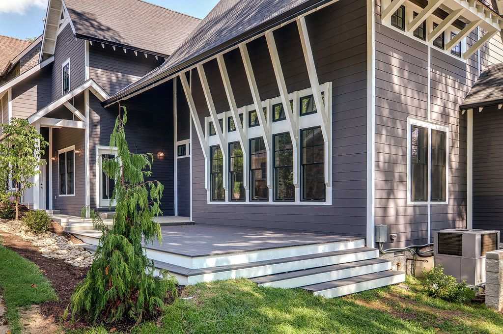Traditional Exterior of Home with Deck Railing, picture window, double-hung window, French doors