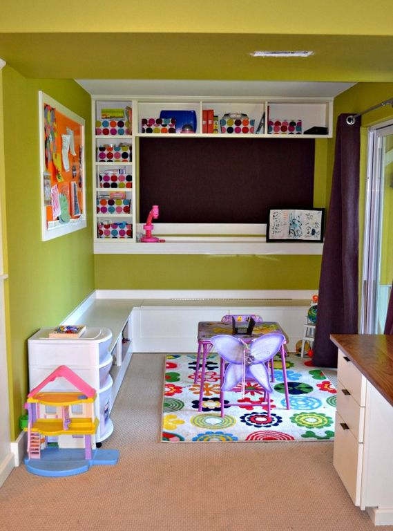 Contemporary Playroom with Area rug, Built-in bookshelf, Standard height, Carpet, Built-in bench seating, Paint