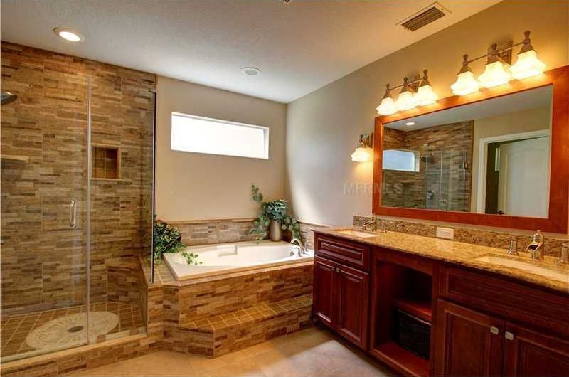 Traditional master bathroom with specialty door complex for Kitchen cabinets zephyrhills fl