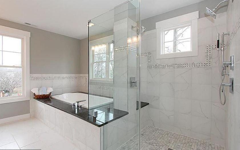 Contemporary Master Bathroom with Wall Tiles, complex marble tile floors, wall-mounted above mirror bathroom light, Bathtub