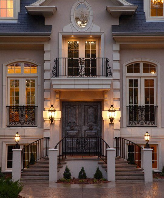 Traditional Exterior of Home with Pathway, French doors, Transom window, Deck Railing, picture window
