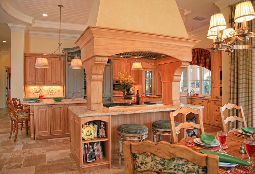 Country Kitchen with built-in microwave, limestone tile floors, Pendant light, U-shaped, can lights, Raised panel, Stone Tile