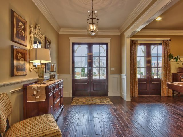 Traditional Entryway with Crown molding, Chair rail, Wainscotting, Paint, French doors, Standard height, Hardwood floors