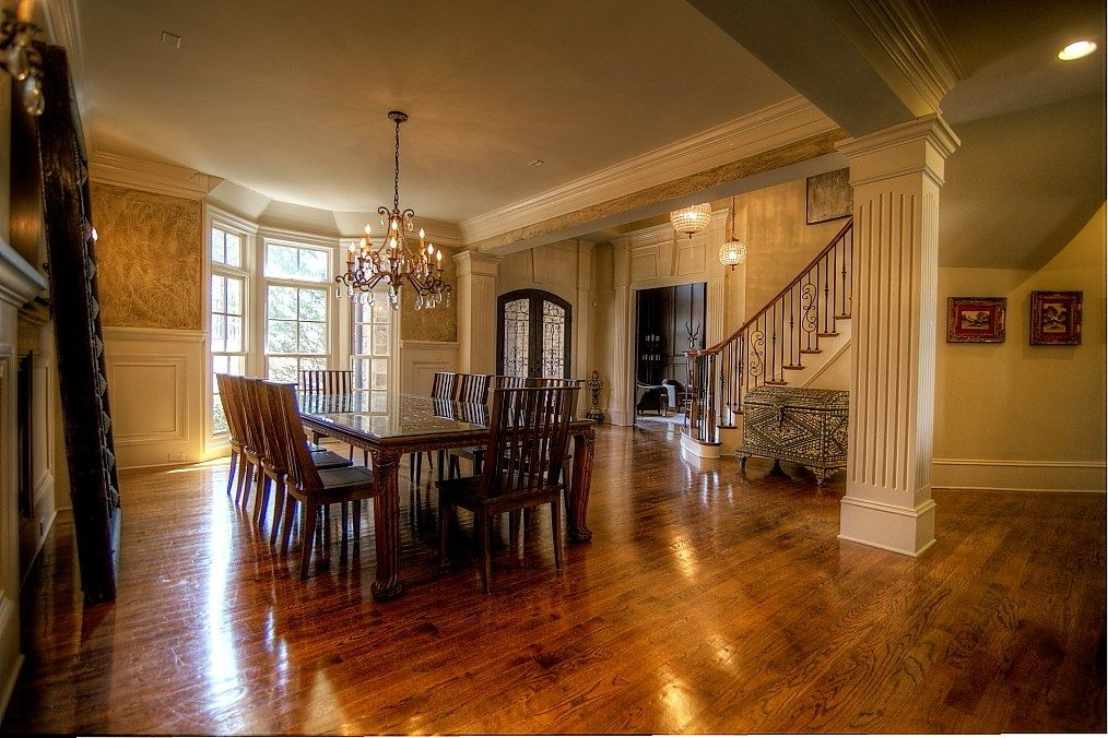 Traditional Dining Room with can lights, Wainscotting, Hardwood floors, French doors, Chandelier, Crown molding, Columns