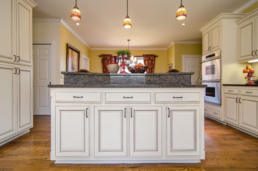 Traditional Kitchen with U-shaped, Simple granite counters, Casement, Raised panel, can lights, Crown molding, six panel door
