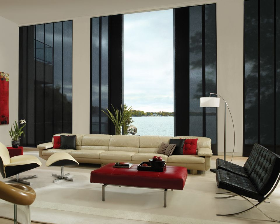 Contemporary Living Room with Laminate floors, picture window, Cathedral ceiling