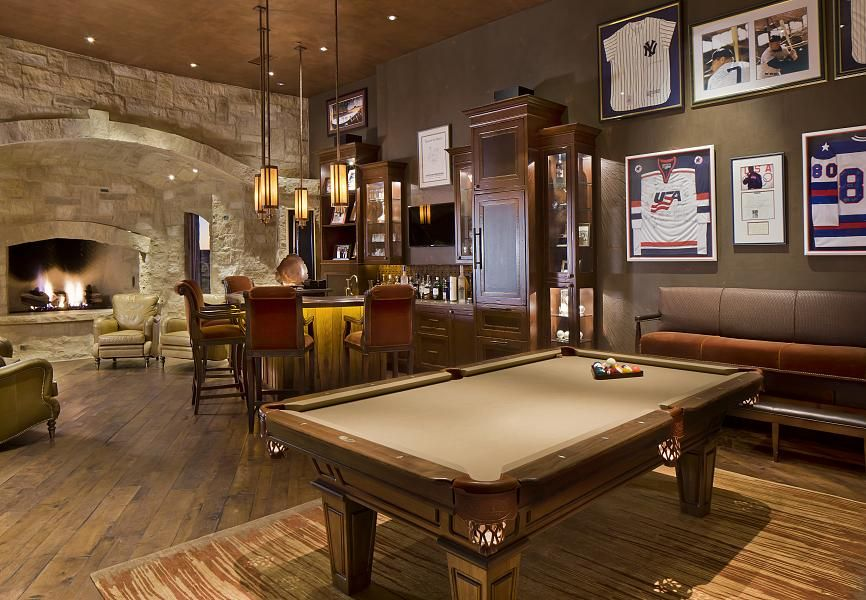 Rustic Game Room with Hardwood floors, Standard height, Built-in bookshelf