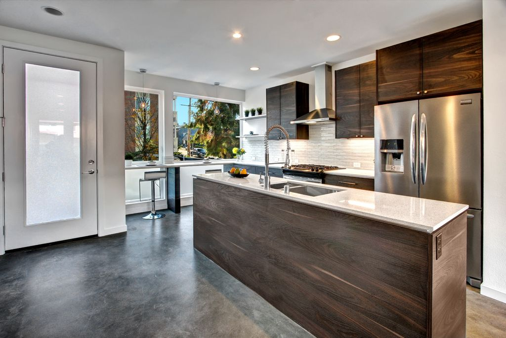 Modern Kitchen with Standard height, L-shaped, Multiple Sinks, picture window, French doors, Wall Hood, Pendant light, Flush
