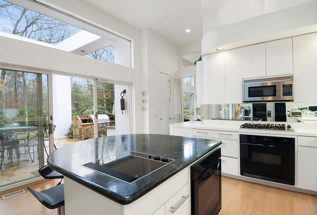 Modern Kitchen with Hardwood floors, Breakfast bar, Soapstone counters, Corian counters, One-wall, Kitchen island