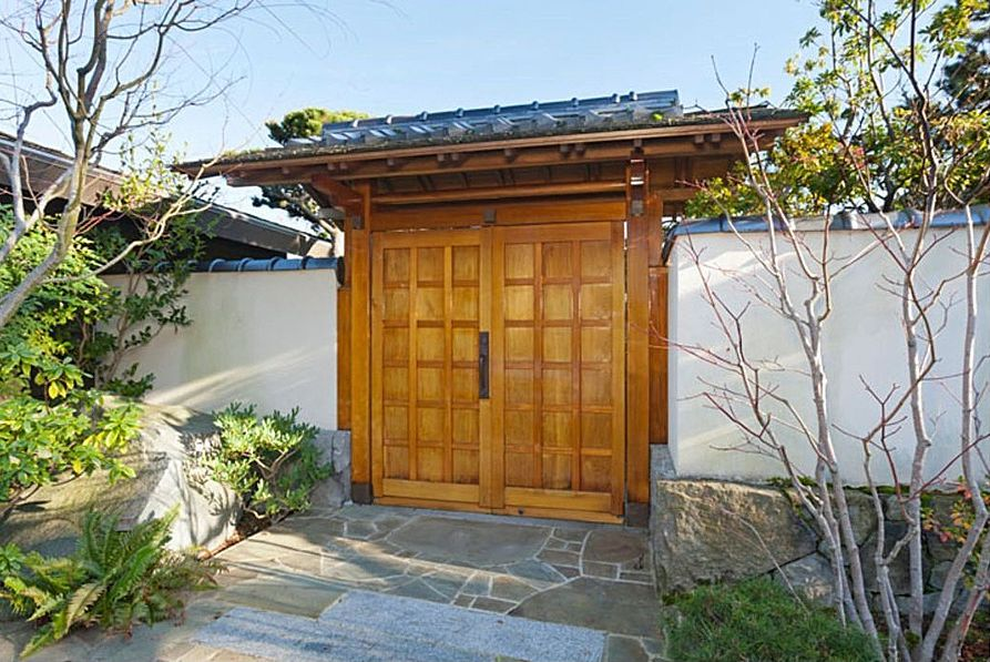 Asian Front of Home with exterior stone floors, Raised beds