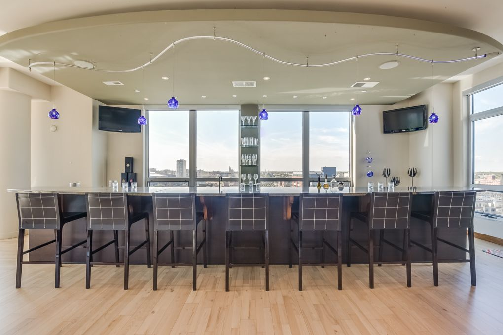 Modern Bar With Hardwood Floors Pendant Light In Milwaukee Wi Zillow Digs