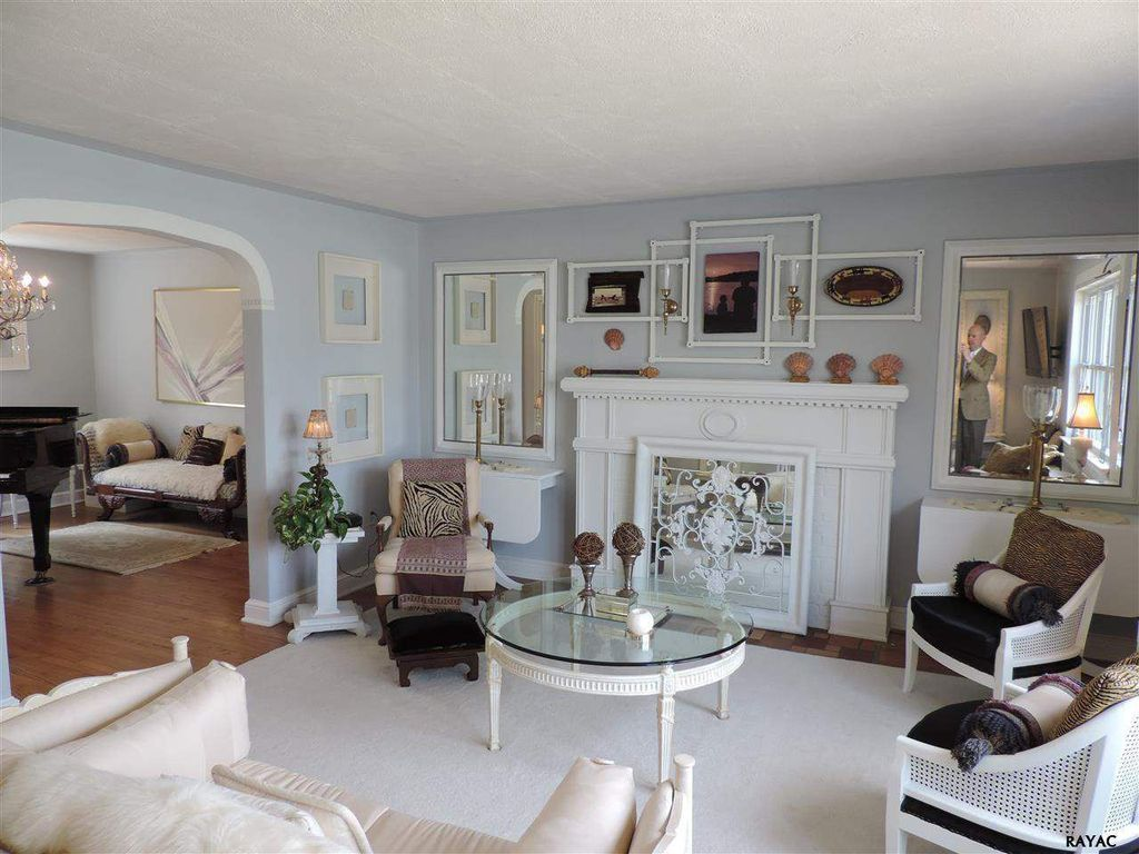 Traditional Living Room with Hardwood floors, metal fireplace