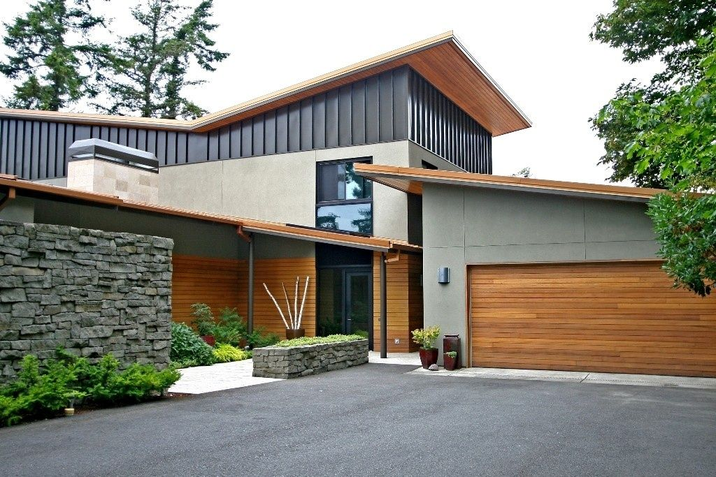 modern exterior of home with french doors exterior tile floors