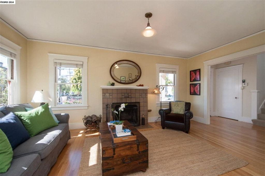 Traditional Living Room with Fireplace, double-hung window, Hardwood floors, Crown molding, stone fireplace, flush light