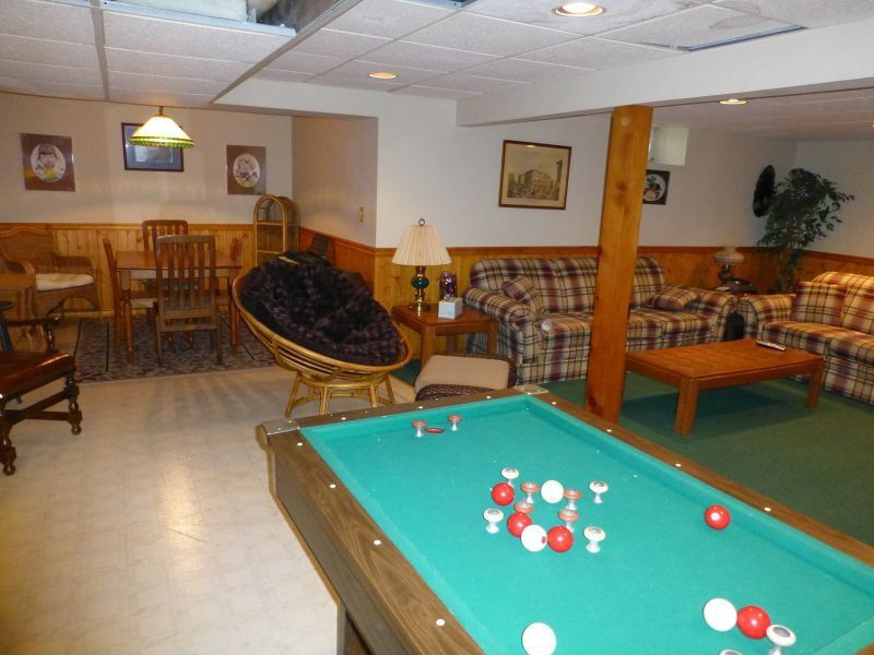 Traditional Game Room with Box ceiling, can lights, stone tile floors, Standard height, Columns, sandstone tile floors