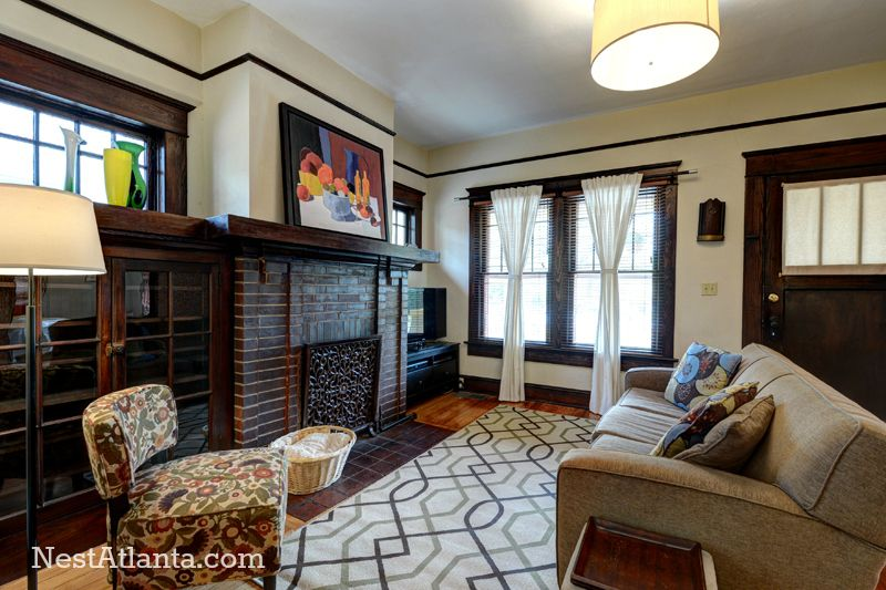 Craftsman Living Room with Fireplace, double-hung window, picture window, flush light, Hardwood floors, metal fireplace