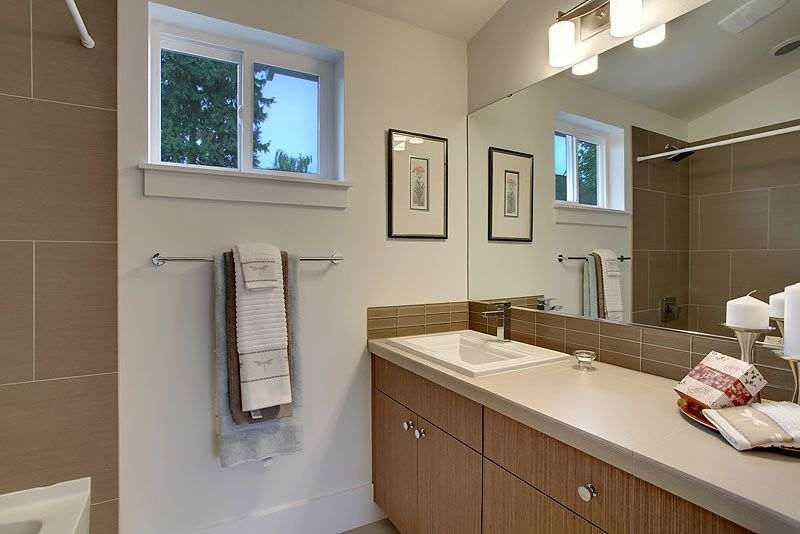 Contemporary Master Bathroom with Wall Tiles, shower bath combo, Jetted showerhead, Casement, Flush, drop-in sink, Shower