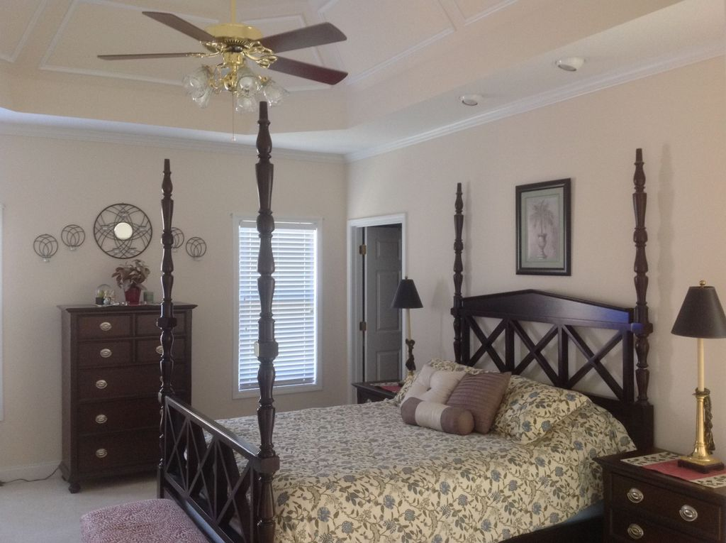 Traditional Master Bedroom with specialty door, Standard height, Carpet, Ceiling fan, Crown molding, can lights