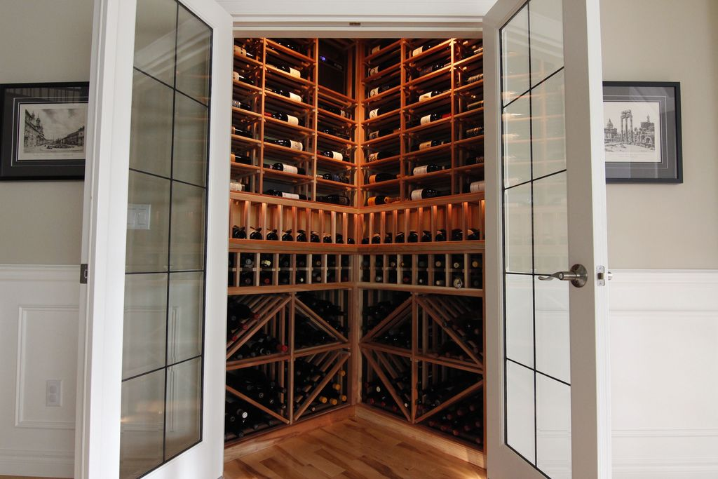 Traditional Wine Cellar with Built-in bookshelf, Hardwood floors, Standard height