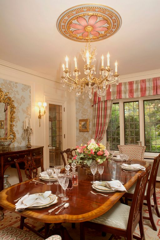 Traditional Dining Room with interior wallpaper, Crown molding, French doors, Hardwood floors, Chandelier