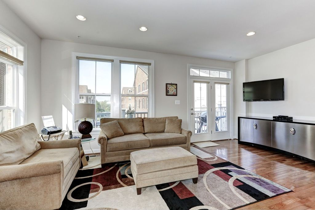 Contemporary Living Room with Transom window, can lights, Standard height, Hardwood floors, French doors, double-hung window