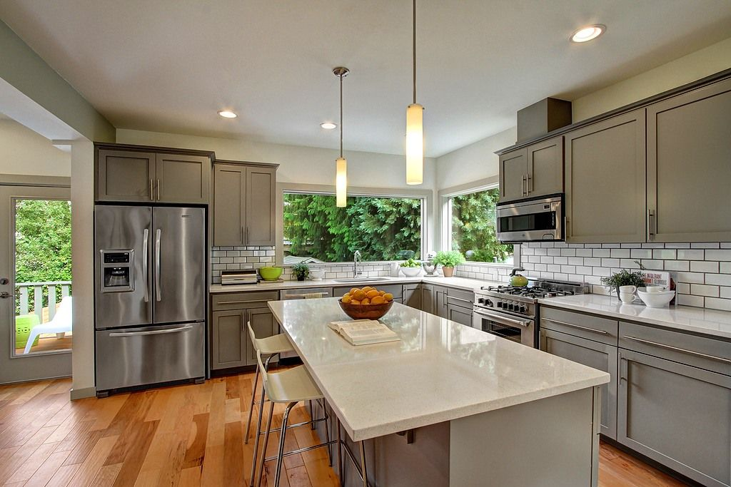 Contemporary Kitchen with picture window, Standard height, dishwasher, full backsplash, Simple granite counters, Subway Tile