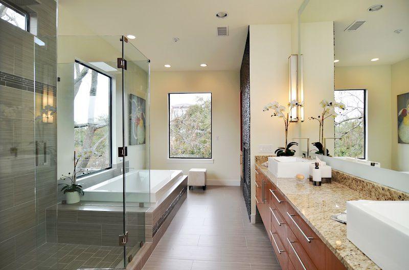 Modern Master Bathroom with Vessel sink, large ceramic tile floors, Complex Granite, picture window, Paint 1, Bathtub, Flush