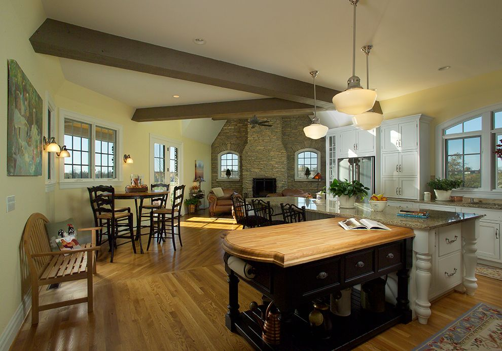 Country Kitchen with Breakfast nook, Casement, One-wall, Wall sconce, Flat panel cabinets, Built In Panel Ready Refrigerator