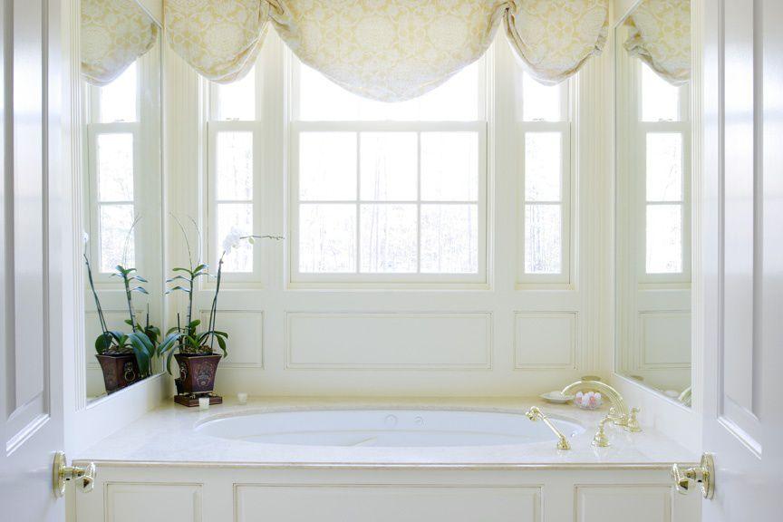 Traditional Master Bathroom with Bathtub, Master bathroom, specialty door, double-hung window, Standard height