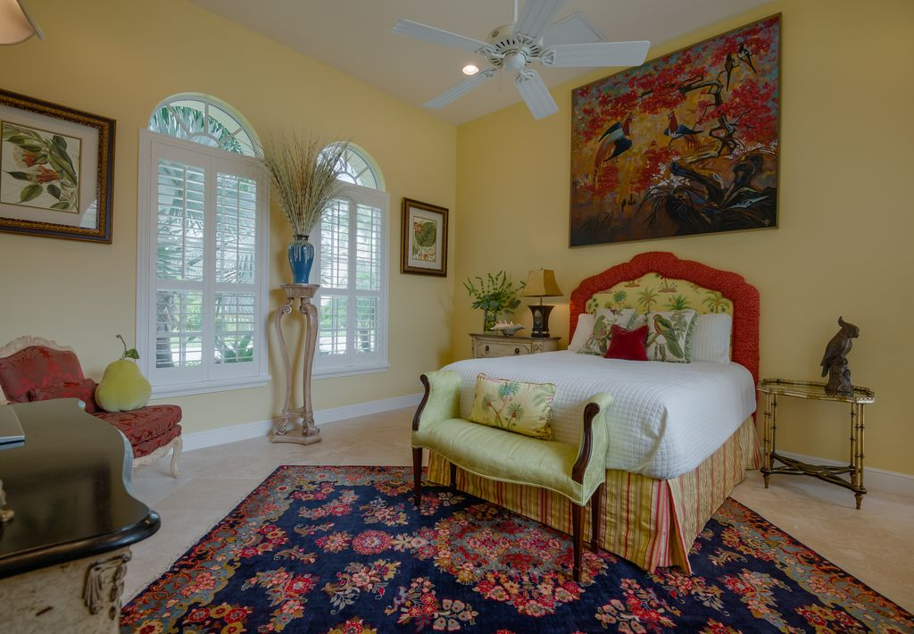 Traditional Guest Bedroom with Standard height, Ceiling fan, sandstone floors, Arched window, can lights