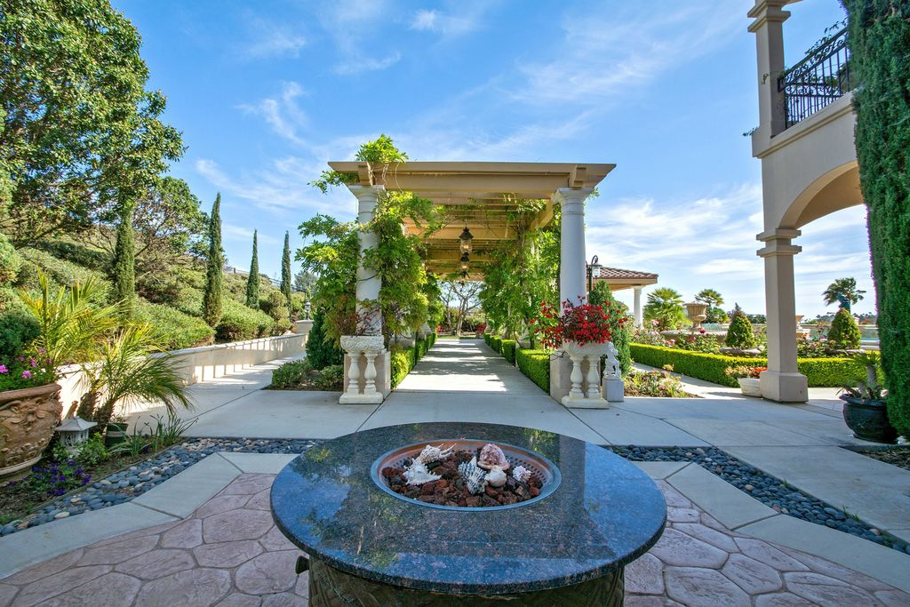 Mediterranean Patio with Trellis, Gazebo, Raised beds, Deck Railing, Pathway, Fountain, Fire pit, exterior stone floors
