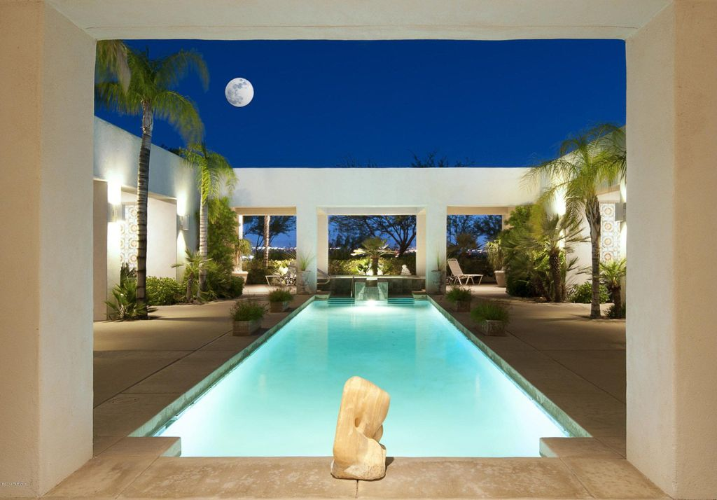 Contemporary Swimming Pool with Raised beds, Fence, Lap pool, exterior concrete tile floors, exterior tile floors