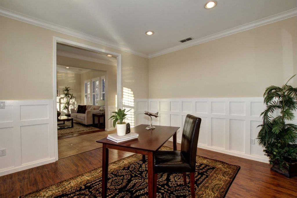 Traditional Home Office with Crown molding, Wainscotting, Hardwood floors, Standard height, can lights