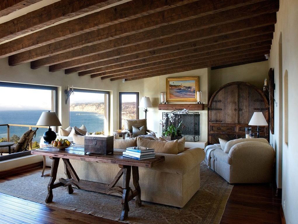 Eclectic Living Room with Exposed beam, Fireplace, Standard height, insert fireplace, metal fireplace, Hardwood floors
